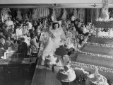 At Palumbo's Cafe, Bride Mrs. Salvatore Cannella Walks Onto Stage, Facing a Revolving Cake Display Lámina fotográfica de primera calidad por Cornell Capa