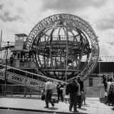 Gyro Globe Ride: Metal Monster Simultaneously Spins and Tilts Victims at Coney Island Photographic Print by Andreas Feininger