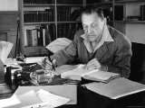 English Novelist and Dramatist W. Somerset Maugham Writing at Desk in Home Premium Photographic Print by Alfred Eisenstaedt