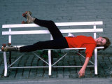Actress Melissa Gilbert Reclining on a Bench While Wearing Roller Skates Premium Photographic Print by David Mcgough