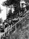 Line of Fun Seekers with Inner Tubes Descending Staircase to Pier for Floating Party on Apple River Premium Photographic Print by Alfred Eisenstaedt