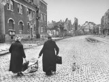 Women of Aachen, walking through the deserted streets carrying bundles or their belongings Premium Photographic Print by John Florea