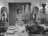 Mercedes de Areilza, Daughter of Spanish Ambassador to Un, Preparing for Dinner Party Premium Photographic Print by Nina Leen