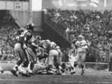 Ny Giants in Dark Jerseys, in a Football Game Against the Green Bay Packers at Yankee Stadium Premium Photographic Print by John Loengard