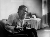 American Poet John Berryman Expressing Himself While Sitting in His Semi Empty Apartment Premium Photographic Print by Mark Kauffman