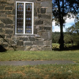 Detail of Small 19th Century Stone Church with Stained Glass Windows in Rural New England Photographic Print by Walker Evans