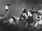 NY Giant Don Chandler Making a Punt in a Football Game Against the Green Bay Packers Premium Photographic Print by John Loengard
