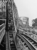 Thrill Seekers Getting a Hair Raising Ride on Cyclone Roller Coaster at Coney Island Amusement Park Photographic Print by Marie Hansen