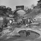 Yangtze River Essay: Women Washing Laundry on Shores of Yangtze River Near Ancient Arched Bridge Photographic Print by Dmitri Kessel