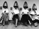 "Women Sitting and Reading under Hairdryers at Rockefeller Center ""Pamper Club"" Premium Photographic Print by Nina Leen"