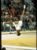 US Gymnast Ludmila Turishcheva Performing a Floor Exercise During the Summer Olympics Premium Photographic Print by John Dominis