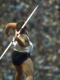 US Track Athlete William Schmidt Throwing Javelin at the Summer Olympics Premium fotografisk trykk av John Dominis