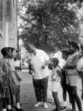 Musician Louis Armstrong with Neighborhood Kids Premium Photographic Print by John Loengard