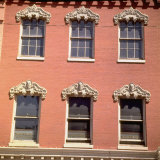 Brick Facade of 19th Century Building with Ornate Stonework Around Windows Photographic Print by Walker Evans