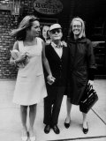 Lee Radziwill, Truman Capote, and Jane Howard Walking Arm in Arm While Leaving the Ivanhoe Theater Premium Photographic Print by Pierre Boulat