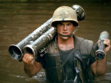 American Marine Pfc. Phillip Wilson Carrying Bazooka Across Stream Near DMZ During Vietnam War Premium Photographic Print by Larry Burrows