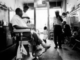Musician Louis Armstrong in His Neighborhood Barber Shop Premium Photographic Print by John Loengard