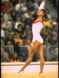 US Gymnast Ludmila Turishcheva Performing a Floor Exercise at the Summer Olympics Premium Photographic Print by John Dominis