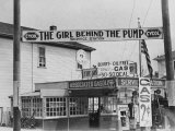Girl Behind the Pump Gas Station Run Entirely by Female Owners Photographic Print by E O Hoppe