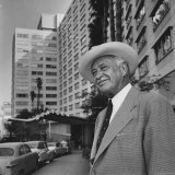 Conrad N. Hilton Standing in Front of the Los Angeles Statler Premium Photographic Print by J. R. Eyerman