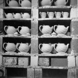 Cheap Chinaware Saucers, Cups, Teapots, Etc Standing on Racks in Pottery of the Hall China Co Photographic Print by Walker Evans