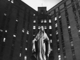 Statue of Mary in front of Catholic Hospital in Chicago, Symbolizing Mother of Mercy Premium Photographic Print by John Dominis