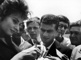 "Actress Sophia Loren Signing Autographs for Fans During Location Filming of ""Madame Sans Gene"" Premium Photographic Print by Alfred Eisenstaedt"