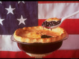 Deep Dish Blueberry Pie, with a scoop in front of the American Flag Photographic Print by Fred Lyon