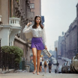 "Long Hair Woman with short skirt, lace top and sandals walking up street in ""New York Look"" fashion Photographic Print by Vernon Merritt III"