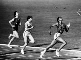 US Runner Wilma Rudolph Winning Women&#39;s 100 Meter Race at Olympics Premium Photographic Print by Mark Kauffman