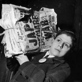 Boy from the Madison Square Boys' Club Carrying a Bundle of Newspapers After Attack on Pearl Harbor Photographic Print by Dmitri Kessel