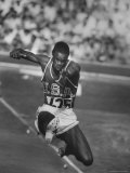 USA Ralph Boston Faulting on His Leap During High Jump Finals at Olympics Premium Photographic Print by Mark Kauffman