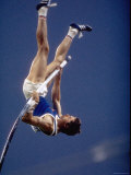 East Germany's Wolfgang Nordwig in Action During Pole Vaulting Event at the Summer Olympics Premium Photographic Print by John Dominis