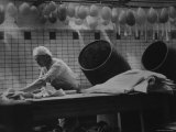 Butcher at Work in a Speck Factory, Working with Sheets of Fat Premium Photographic Print by E O Hoppe