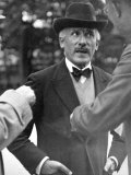 Famous Maestro Arturo Toscanini Stopping in Street and Talking to 2 Men Premium Photographic Print by Alfred Eisenstaedt