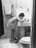 Child Star Margaret O'Brien Brushing Her Teeth Premium Photographic Print by Bob Landry