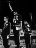 African American Track Star Tommie Smith, John Carlos After Winning Gold and Bronze Olympic Medal Lámina fotográfica de primera calidad por John Dominis