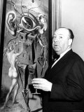 "Film Director Alfred Hitchcock, Standing Beside Salvador Dali's Painting ""Movies"" Premium Photographic Print by Herbert Gehr"