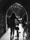 College Co-Ed Walking Bicycle Through an Archway on the Campus of Princeton University Premium Photographic Print by Alfred Eisenstaedt