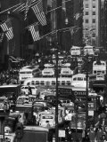 Pre-Christmas Holiday Traffic on 57th Avenue, Teeming with Double Decker Busses, Trucks and Cars Photographic Print by Andreas Feininger