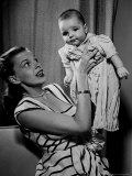 Singer and Actress Judy Garland Holding Her Darling Baby Daughter Liza at Home Premium Photographic Print by Martha Holmes