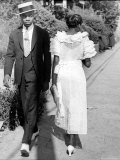 African American Sporting His Sunday Finery Glancing at Frilly Frocked Girl Passing Him on Street Premium Photographic Print by Alfred Eisenstaedt