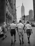 Three Young Businessmen Wearing Bermuda Shorts as They Walk Along Fifth Ave. During Lunchtime Premium Photographic Print by Lisa Larsen