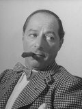 Comedian George Jessel, Wearing Houndstooth Jacket and Bow Tie, Smoking a Cigar Premium Photographic Print by John Florea