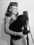 Dinah Shore Taking Part in a Radio Show for Servicemen Overseas Premium Photographic Print by John Florea