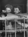 Actress Joan Fontaine with Actress Sister Olivia de Havilland Looking Out of Open Window at Home Premium Photographic Print by Bob Landry