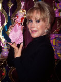 Actress Barbara Eden Holding Up Jeannie Doll Premium Photographic Print by Dave Allocca