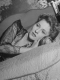 Actress Joan Fontaine Wearing Sheer Negligee While Lounging on Bed at Home Premium Photographic Print by Bob Landry