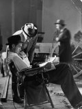"""Millionaire Howard Hughes/Movie Studio Owner Studying Script on the Movie Set for """"The Outlaw"""" Premium Photographic Print by Bob Landry"""