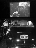 Female Car-Hop Taking Order from Couple in Convertible Car During Movie at Rancho Drive in Theater Premium Photographic Print by Allan Grant